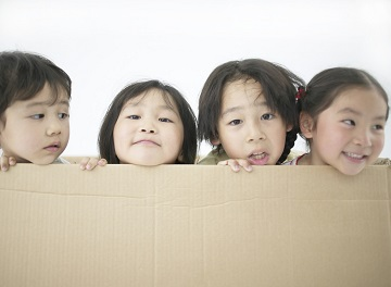 Four Children in Cardboard Box